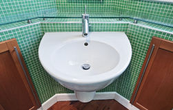 Bathroom with green mosaic tiles Royalty Free Stock Photography