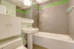 Bathroom with grey wall and green tile trim Royalty Free Stock Photography