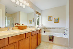 Bathroom with honey tone vanity cabinet Royalty Free Stock Image