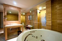 Bathroom Hotel. Luxury bathroom with sink and shower walls and marble floors Royalty Free Stock Image