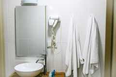 Bathroom in the hotel with all the necessary bathroom accessories for the tourist. Modern bathroom Stock Photo