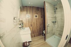 A bathroom in the hotel, shot on a fisheye lens. Stock Image