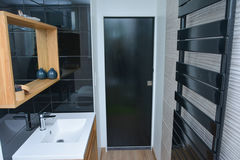 Bathroom in a house. Black style stock photo