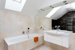 Bathroom with huge mirror. Bath and white sink stock photography