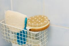 Bathroom objects. Sponges, brushes in shower container Royalty Free Stock Photo