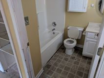 2 Bathroom Before Inspection: Floor Needs Replaced, Bid Yes needs. Mark For Performance Indiana Property Preservation stock photos