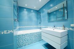 Bathroom interior. Modern luxury bathroom blue interior. No brandnames or copyright objects Royalty Free Stock Image