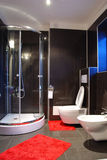 Bathroom interior. Modern decorated bathroom in black and red colors Stock Images