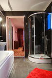 Bathroom interior. Modern decorated bathroom in black and red colors Royalty Free Stock Images