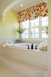 Bathroom interior. Nicely decorated bathroom interior with window Royalty Free Stock Photo