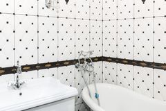 Bathroom interior in art deco style. Classic bathroom and washbasin in combination with beautiful ceramic tiles stock image