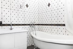 Bathroom interior in art deco style. Classic bathroom and washbasin in combination with beautiful ceramic tiles royalty free stock image