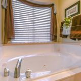 Bathroom interior with a bathtub and large window royalty free stock photo