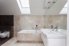 Bathroom interior with beige tiles Stock Photo