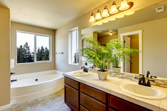 Bathroom interior with beige walls and tile flooring. Stock Photos