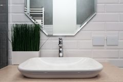 Bathroom interior. Bright bathroom with new tiles. New washbasin, white sink and large mirror. Bathroom interior. Bright bathroom with new tiles. New washbasin royalty free stock photography