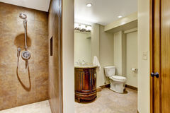 Bathroom interior with carved wood vanity cabinet Stock Photos
