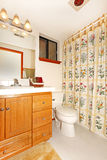 Bathroom interior with floral curtains Royalty Free Stock Images