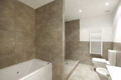 Bathroom interior with marble brown walls stock photography