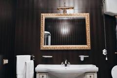 Bathroom interior mirrors and washbasin Stock Photos