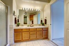 Bathroom interior with opened white door Stock Photos