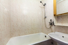 Bathroom. Interior photo of the empty small bathroom with bathtub, shower and sink Royalty Free Stock Photos