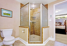 Bathroom interior with screened shower. Bathroom interior in light beige with screened shower and exit to master bedroom Stock Photography