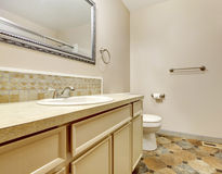 Bathroom interior with tile floor and framed mirror in small hou Stock Photography