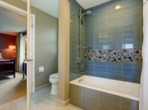 Bathroom interior with tile shower wall, and floor. Stock Photography
