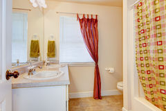 Bathroom interior with two sinks and big mirror. Also red curtain. Stock Photography