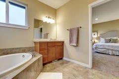 Bathroom interior with vanitiy cabinet and bathtub Royalty Free Stock Photo