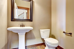 Bathroom interior. View of white sink, toilet and mirror Royalty Free Stock Image
