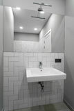 Bathroom interior with a wash basin, sink and mirror Stock Photo