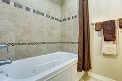 Bathroom interior with white shower bath tub Stock Photos
