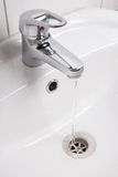 Bathroom interior with white sink and faucet Royalty Free Stock Photo