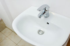 Bathroom interior with white sink and silver faucet Royalty Free Stock Photo