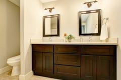 Bathroom interior in white tones with black vanity cabinet. Northwest, USA Stock Photos