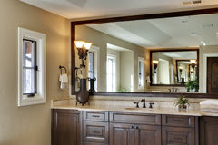 Bathroom with Large Mirror. Bathroom with large his and hers sinks visible in main view and reflection Royalty Free Stock Image