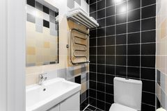 Bathroom with shower, toilet bowl and sink. Hotel standart bedroom. simple and stylish interior. interior lighting. Bathroom with large shower, toilet bowl and stock photo