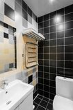 Bathroom with shower, toilet bowl and sink. Hotel standart bedroom. simple and stylish interior. interior lighting. Bathroom with large shower, toilet bowl and royalty free stock photos