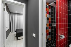 Bathroom with shower, toilet bowl and sink. Hotel standart bedroom. simple and stylish interior. interior lighting. Bathroom with large shower, toilet bowl and royalty free stock images