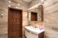 Bathroom in luxury home with bath and furniture royalty free stock image