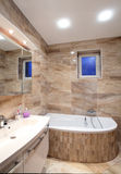 Bathroom in luxury home with bath and furniture Stock Photography