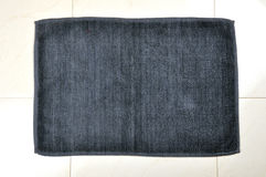 Bathroom mat. On tiles background Royalty Free Stock Photo