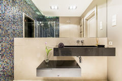Bathroom with minimalistic sink and mosaic wall Stock Photo