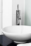 Bathroom modern contemporary stilish sink basin faucet tap ceramic water on Stock Photos