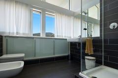 Bathroom of modern house Stock Photos