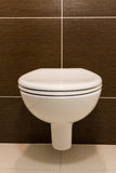 Bathroom. Modern toilet seat decoration in bathroom interior Royalty Free Stock Photo