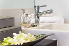 Bathroom in modern townhouse. Bathroom detail in modern townhouse with flowers and perfume royalty free stock photo