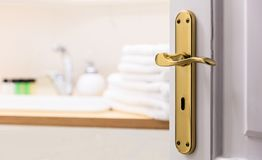 Bathroom from open door. Blur white towels, soap next to the sink. Close up, blur backdrop, details. Bathroom from open door. Blurred background, white towels royalty free stock photos